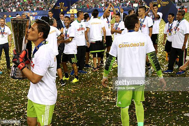 Moises Muoz of Mexico kisses the trophy after defeating Jamaica in the CONCACAF Gold Cup Final at Lincoln Financial Field on July 26 2015 in...