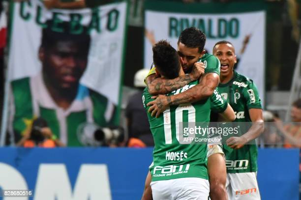 Moises of Brazil's Palmeiras celebrates his goal with teammate Dudu scored against Ecuador's Barcelona during their 2017 Copa Libertadores football...