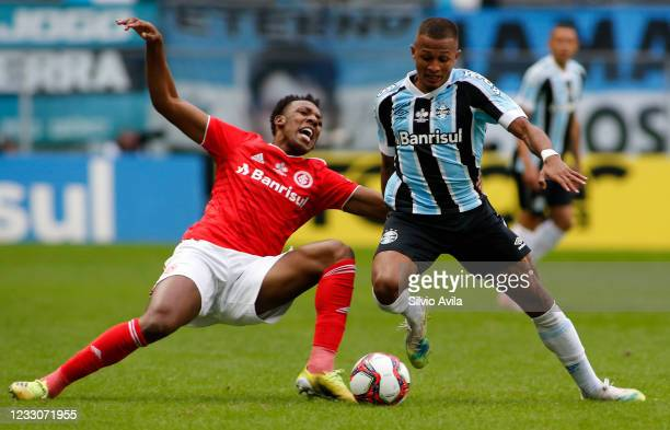 Moises of Internacional and Leo Pereira of Gremio fight for the ball during the final of Rio Grande Do Sul State Championship 2021 between Gremio and...