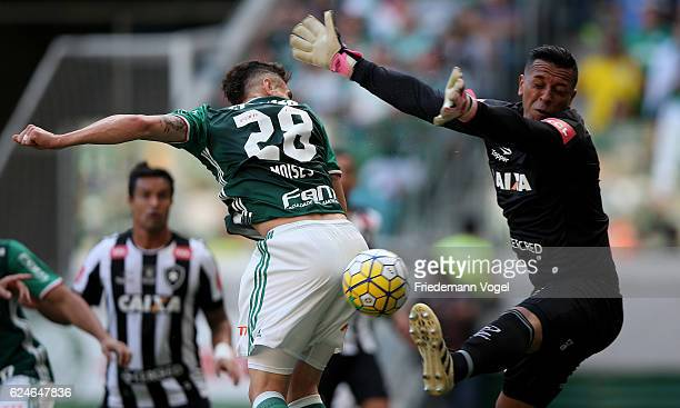 Moises of Palmeiras fights for the ball with Sidao of Botafogo during the match between Palmeiras and Botafogo for the Brazilian Series A 2016 at...