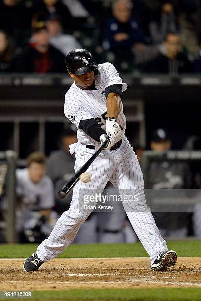 Moises Sierra of the Chicago White Sox connects on a gamewinning RBI single scoring Leury Garcia during the ninth inning against the Cleveland...