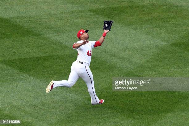 Moises Sierra of the Washington Nationals catches a fly ball during a baseball game against the Colorado Rockies at Nationals Park on April 15 2018...