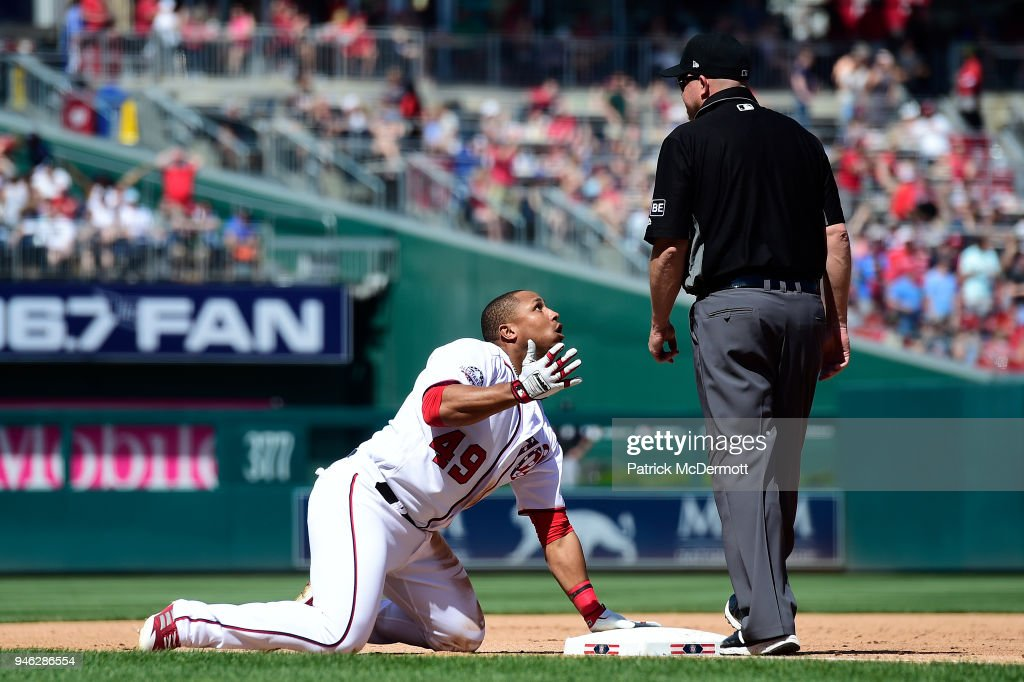 Moises Sierra #49 of the Washington Nationals reacts after being called out stretching to third on a two-run RBI double in the sixth inning against the Colorado Rockies at Nationals Park on April 14, 2018 in Washington, DC.