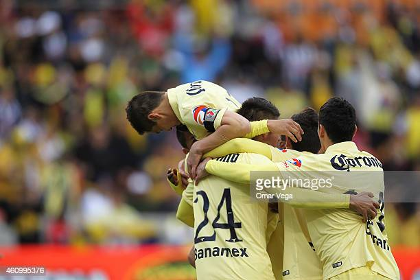 Moises Velasco of America celebrates with teammates after scoring the opening goal during a friendly match between America and Monterrey at BBVA...