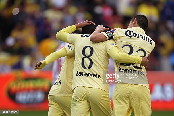 Moises Velasco of America celebrates with temmates after scoring the opening goal during a friendly match between America and Monterrey at BBVA...