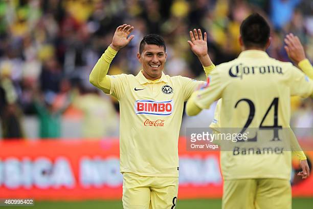 Moises Velasco of America de celebrates after scoring the opening goal during a friendly match between America and Monterrey at BBVA Compass Stadium...