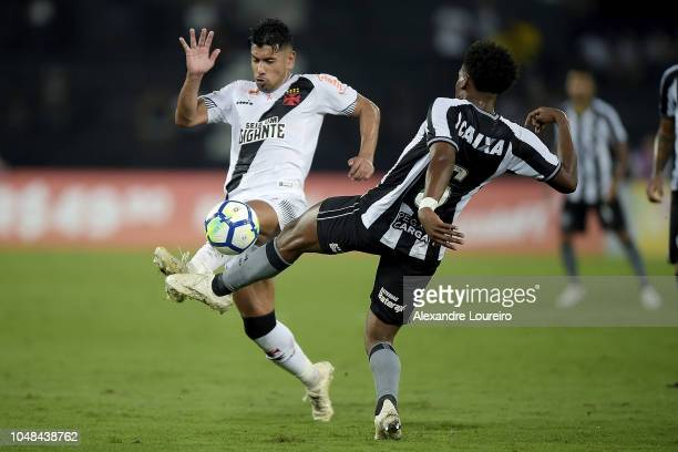 Moisés of Botafogo struggles for the ball with Andrés Rios of Vasco da Gama during the match between Botafogo and Vasco da Gama as part of...