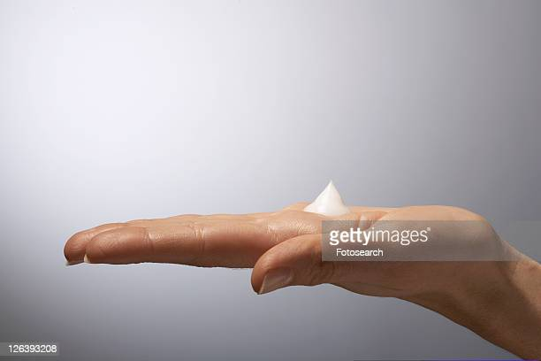 Moisturizer on woman's hand, close-up