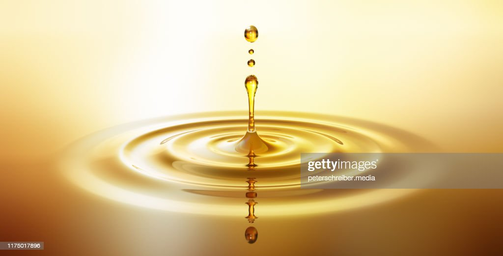Moisturizing cosmetic oil drop with ripples : Stock Photo