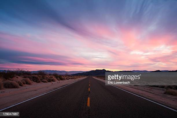 mojave desert sunset on lonely, wide open road - san bernardino california stock pictures, royalty-free photos & images