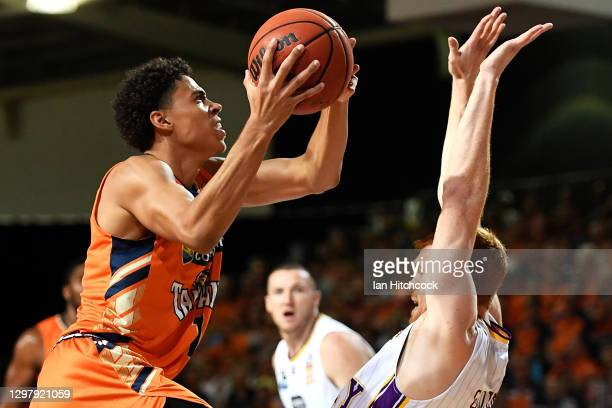 Mojave King of the Taipans drives the ball to the basket over Angus Glover of the Kings during the round two NBL match between the Cairns Taipans and...