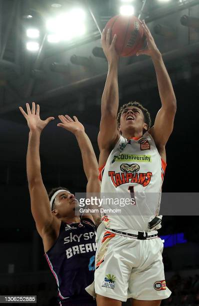 Mojave King of the Taipans shoots under pressure during the NBL Cup match between the New Zealand Breakers and the Cairns Taipans at John Cain Arena...