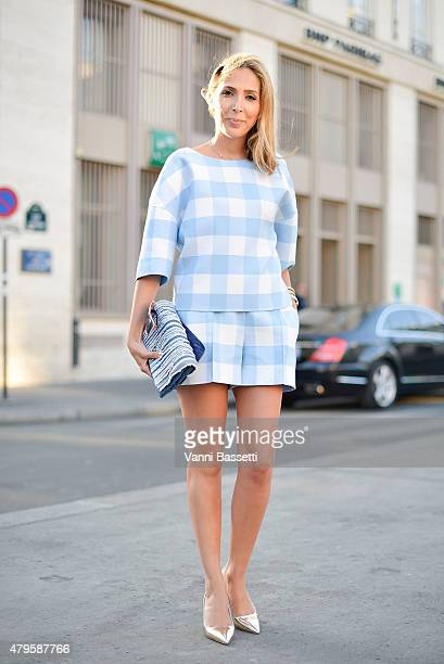 Mojeh Izadpanah poses wearing an Oscar de la Renta dress Chanel Bag and Prada shoes after the Atelier Versace show at the Palais Brogniart on July 5...