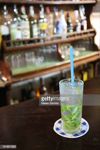 Mojito cocktail in bar in tavern with bottles