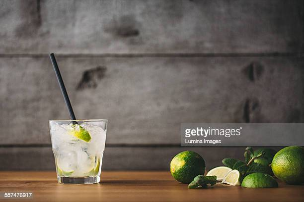 mojito cocktail with lime and mint - mojito stock photos and pictures