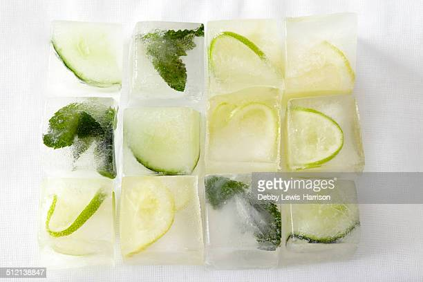 mojito ice cubes - frozen fruit stock pictures, royalty-free photos & images