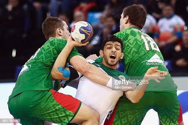 Mojtaba Alsalem of Saudi Arabia is challenged by Artsem Karalek and Siarhei Shylovich of Belarus during the 25th IHF Men's World Championship 2017...