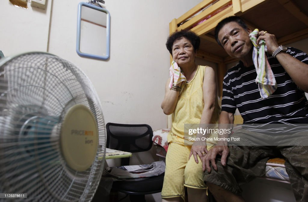 Mok Chau-sin and his wife shared a windowless subdivided flat, enduring temperature of up to 32 degrees Celsius amid the summer heat wave. He urged the government of more efficient public housing arrangements. Cheung Sha Wan. 05AUG12 : News Photo