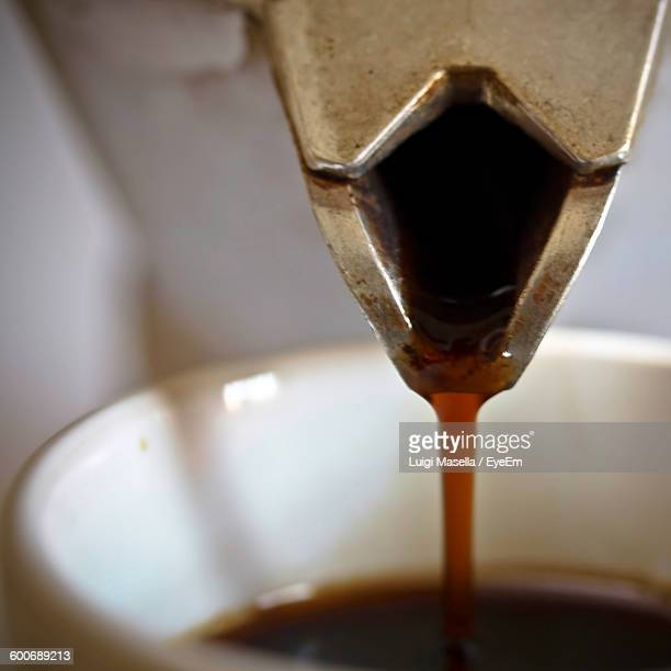 Moka Pot Pouring Coffee In Cup