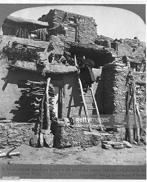 A Moki squaw reaches home with water carried two miles from a government well Oraibi Arizona 1904