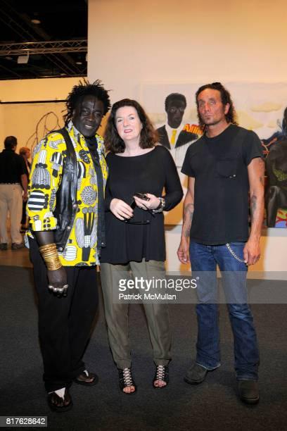 Moko Lynne Sable and Richard Stark attend ART BASEL MIAMI BEACH 2010 at Miami Beach Convention Center on December 1 2010 in Miami Beach Florida
