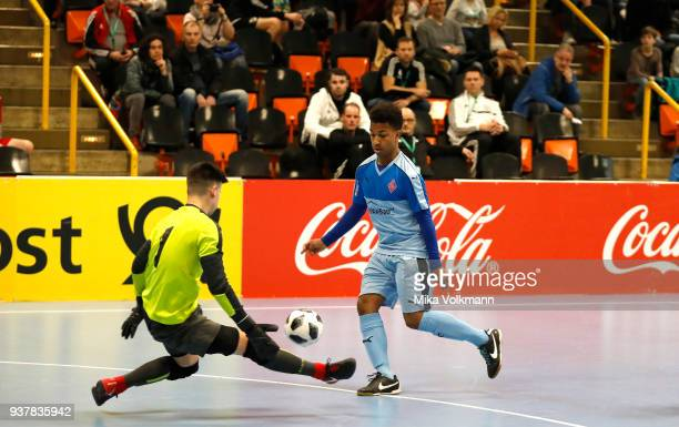 Mola Kahn of Blumenthal challenges goalkeeper Kevin Neumann of VFB Eppingen during the DFB Indoor Football half final match between Blumenthaler SV...