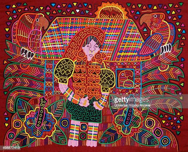 Mola textile by Kuna Indian artist, depicting a Kuna woman in front of her house. From the San Blas Archipelago, Panama. Reverse applique design worn...