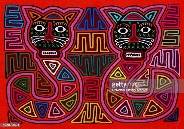 Mola textile by Kuna Indian artist depicting a monster From the San Blas Archipelago Panama Reverse applique design worn on female blouse Two cat...
