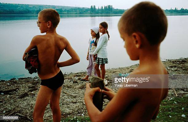 Moldavian children stand by the Dniester River separating Moldova and Transnistria in the village of Viscauti September 2002 in Moldova After the...
