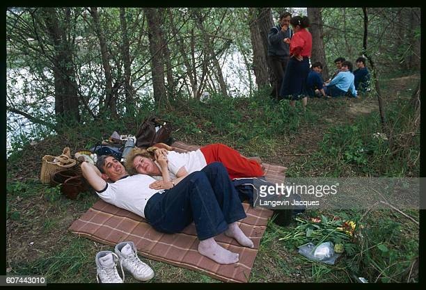Moldavians relax at a giant picnic on the Soviet side of the Prut River celebrating the opening of the SovietRomanian border dividing the country...