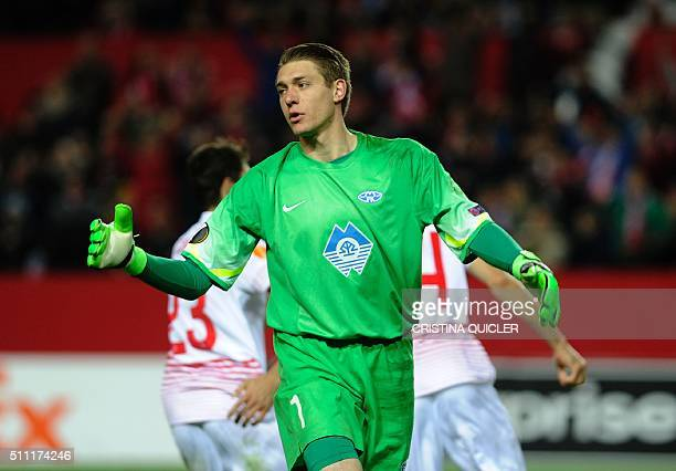 Molde FK's US goalkeeper Ethan Horvath gestures after Sevilla's goal during the UEFA Europa League Round of 32 first leg football match Sevilla FC vs...