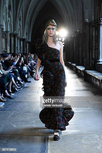A moldel walk the runway during the Gucci Cruise 2017 fashion show at the Cloisters of Westminster Abbey on June 2 2016 in London England