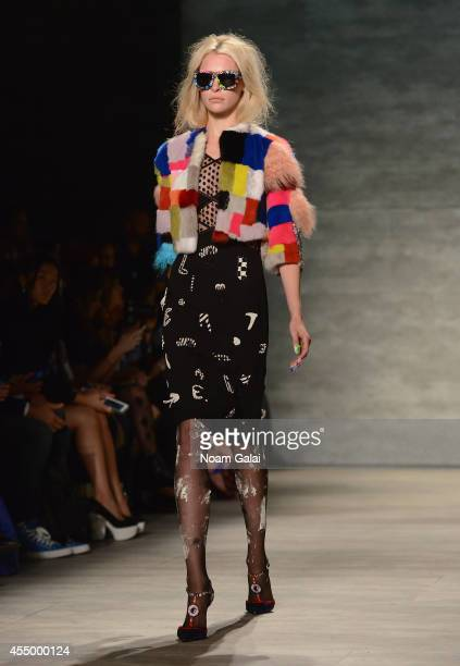 A moldel walks the runway at CND for Libertine S/S 2015 on September 8 2014 in New York City