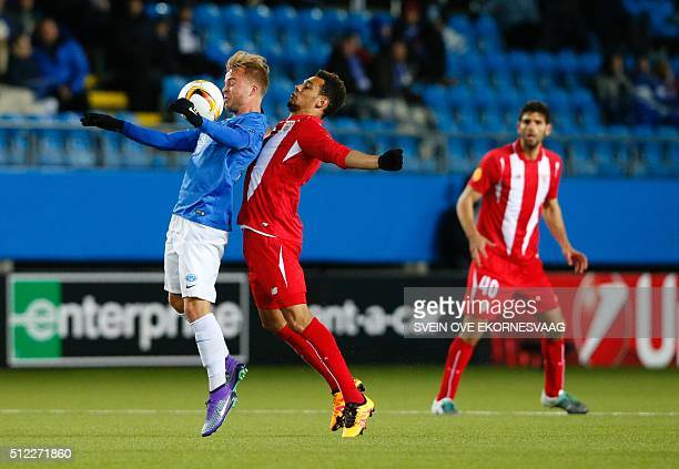 Molde's Sander Svendsen and Sevilla's French defender Timothee Kolodziejczak vie during the UEFA Europa League Round of 32 match football between...
