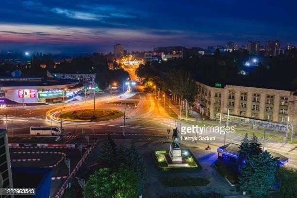 moldova, chisinau, cityscape illuminated at dusk - chisinau stock pictures, royalty-free photos & images
