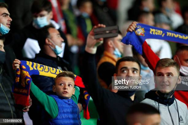 Moldova fans wait for the start of the FIFA World Cup Qatar 2022 qualification football match between Moldova and Austria at Zimbru stadium in...