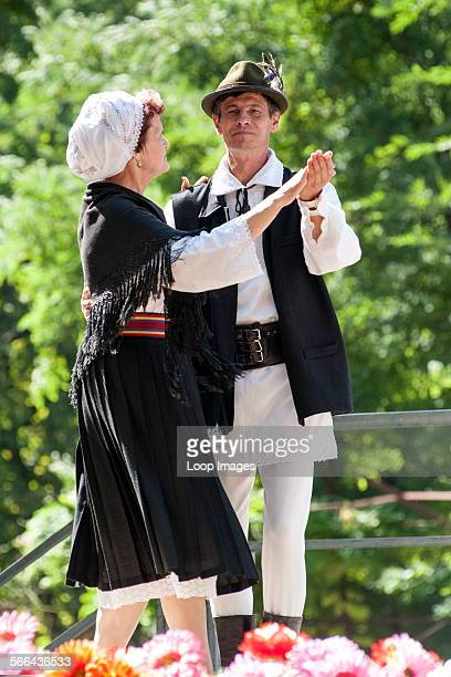 Moldovan couple in traditional costume dancing during Limba Noastra festivities in Chisinau which is the capital of Moldova in Eastern Europe.