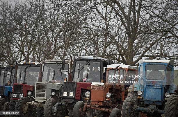 Moldovan farmers protest for better subsidies on March 27 2015 near the village of Causeni 60kms southeast of Chisinau In July 2014 Russia...