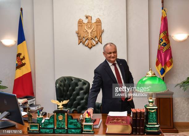 Moldovan President Igor Dodon smiles during an interview with AFP at his office at The Moldovan Presidency headquarters in Chisinau city, on June 11,...