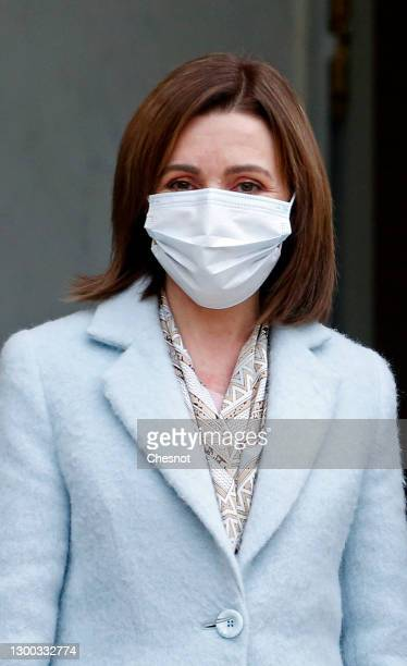 Moldovan President Maia Sandu wearing a protective face mask poses for photographers prior to a working lunch with French President Emmanuel Macron...