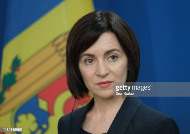 Moldovan Prime Minister Maia Sandu and German Chancellor Angela Merkel speak to the media following talks between the two leaders at the Chancellery...