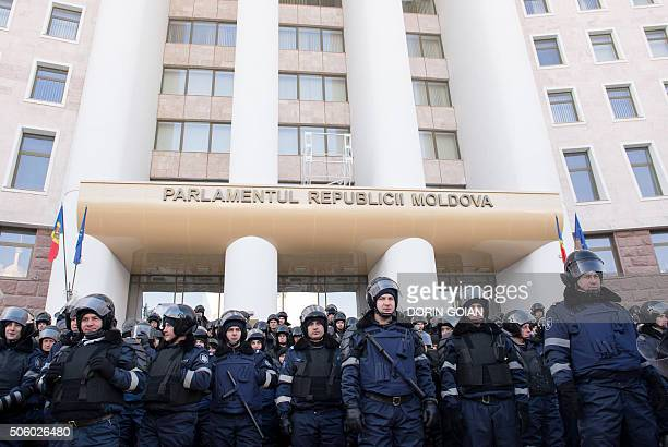 Moldovan riot police block the Parliament building from protesters in Chisinau on January 21, 2016. Moldova braced for fresh protests on Thursday...