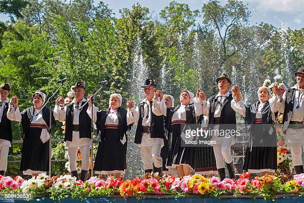 Moldovans in traditional costume celebrating Limba Noastra in Chisinau which is the capital of Moldova in Eastern Europe.