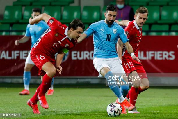 Moldova's defender Alexandu Epureanu, Israel's forward Moanes Dabour and Moldova's defender Ion Jardan vie for the ball during the FIFA World Cup...