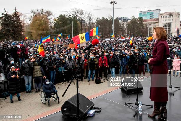 Moldova's President-elect Maia Sandu addresses supporters as she takes part in a rally to demand the government's resignation and snap parliamentary...