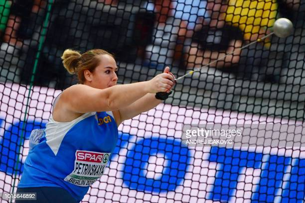 Moldova's Zalina Petrivskaya competes in the women's Hammer Throw final during the European Athletics Championships at the Olympic stadium in Berlin...