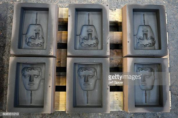 Molds are readied as the iconic bronze masks are cast in to the BAFTA trophy for the 2016 British Academy of Film and Television Arts award ceremony...