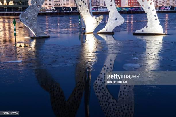 Molecule Man on icy spree river in Berlin Treptow