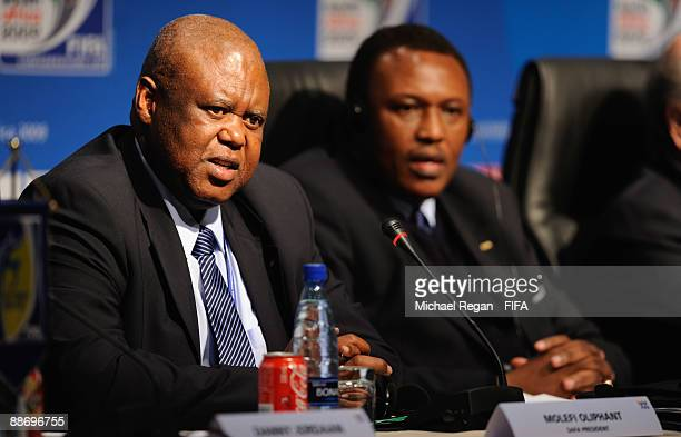 Molefi Oliphant talks to the media as Irvin Khoza looks on during the FIFA/LOC Press Conference on June 26 2009 in Johannesburg South Africa