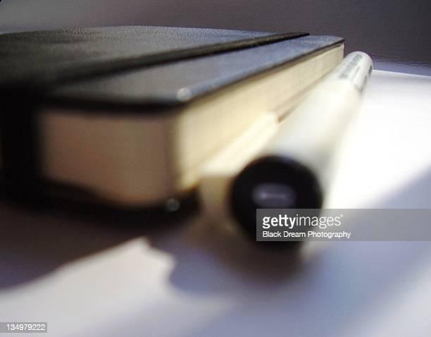 Moleskine notebook and pen